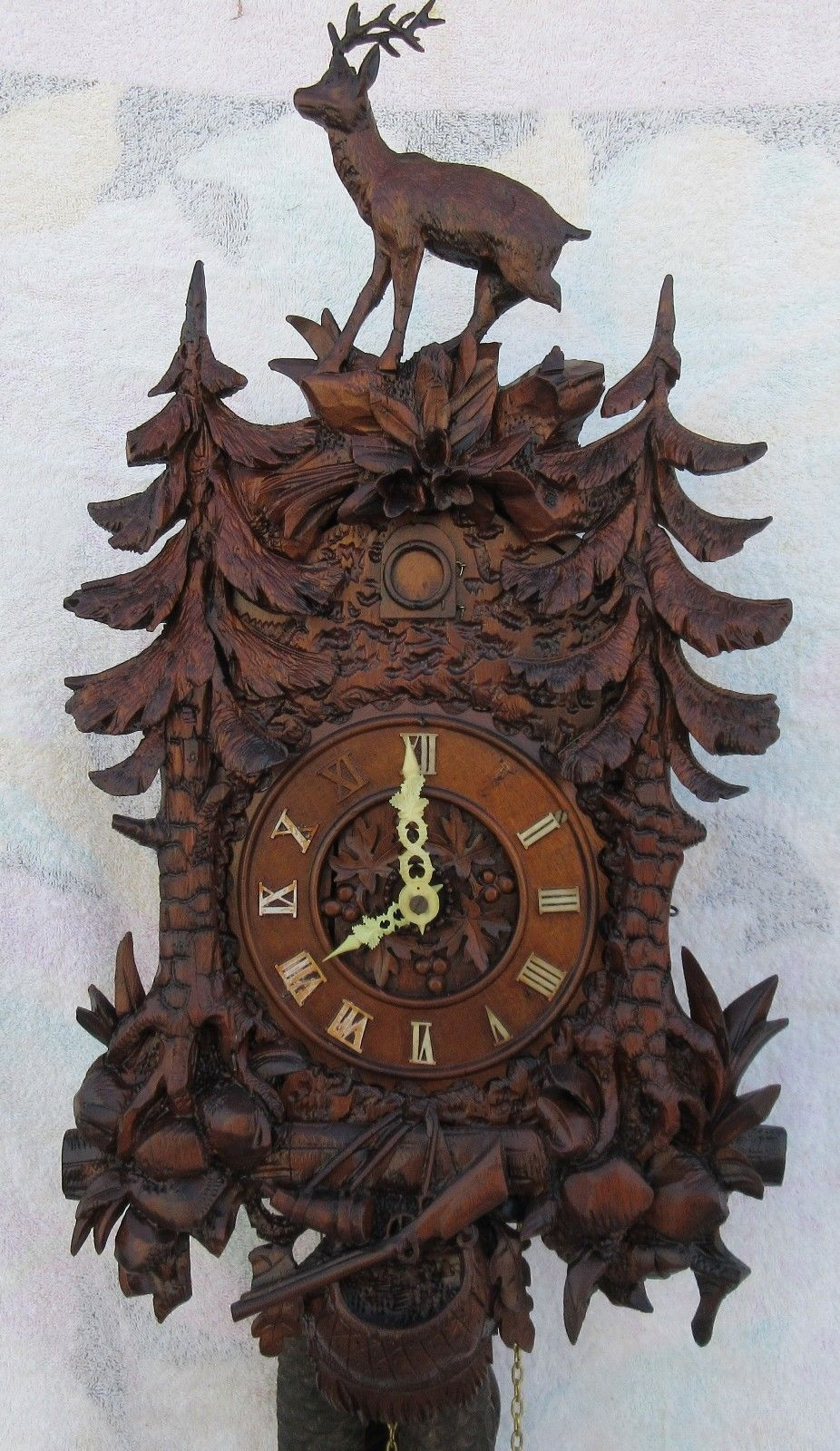 Beautiful German cuckoo clock with deer on top