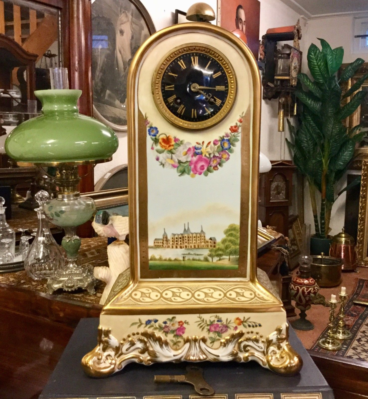 Antique porcelain mantle clock dates back to the 1860's and originates from France