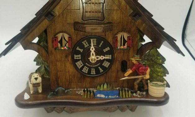Fisherman-themed cuckoo clock crafted in black forest Germany